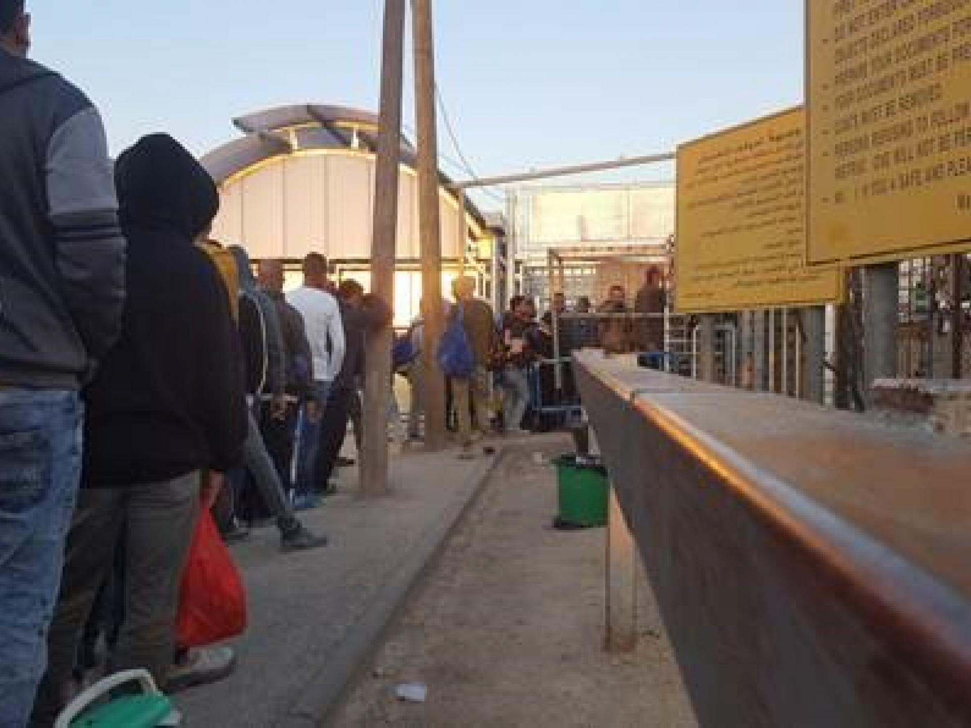 Barta'a Checkpoint – morning waiting line, standing and waiting together