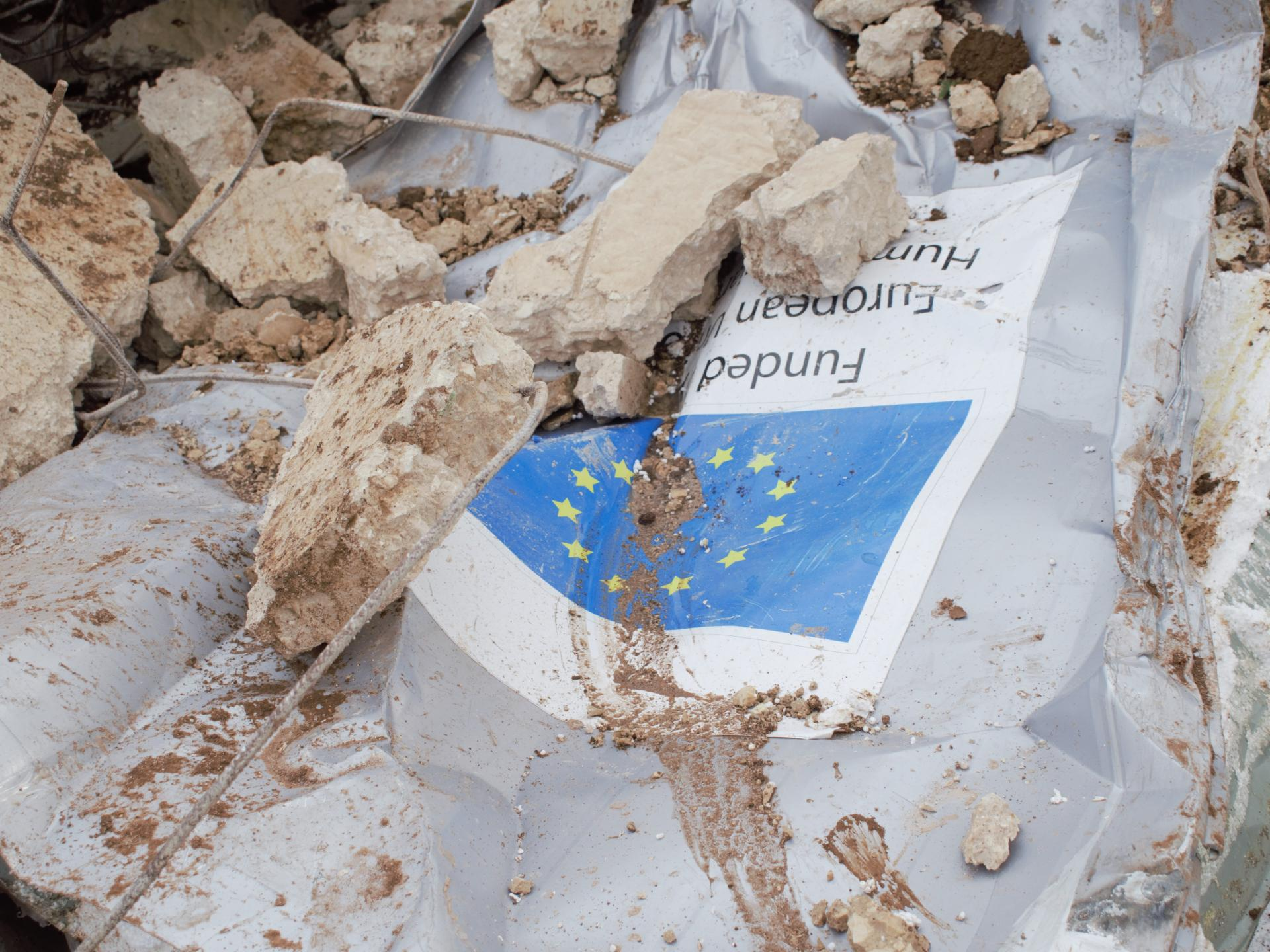 The demolished caravan at Furush Beit Dajan, with the plaque identifying it as a donation by the European Union