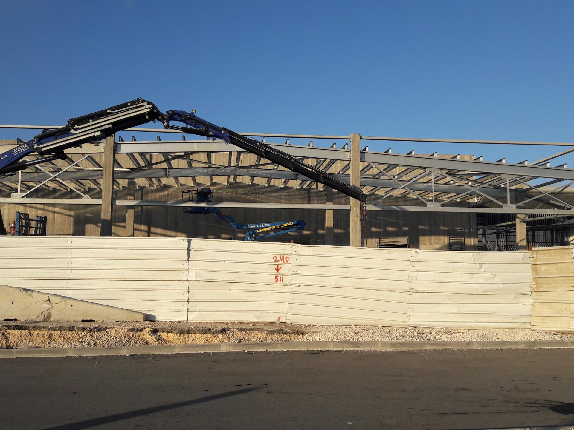 The beginning of a roof in the new building sites – apparently a new shed