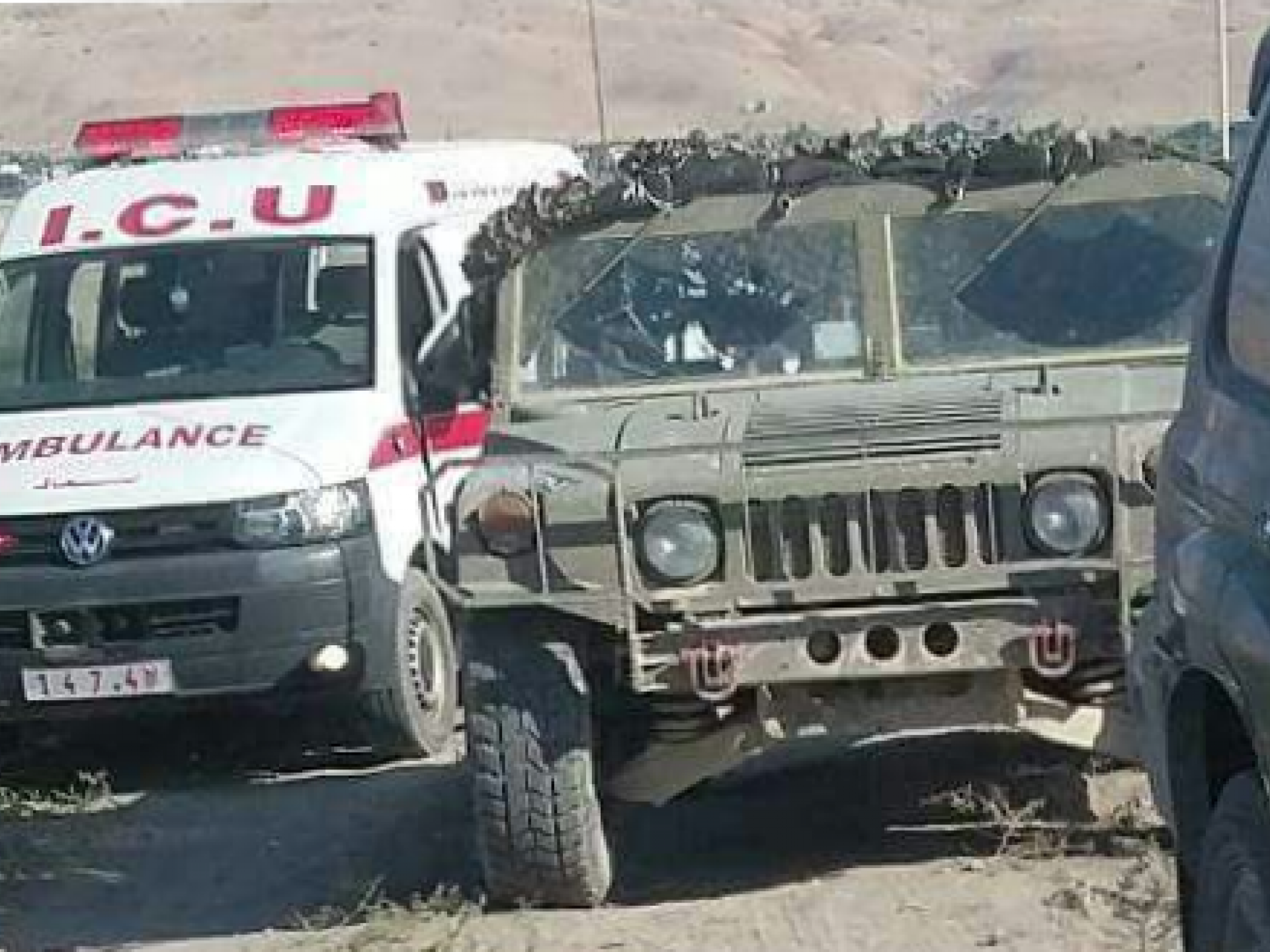 Palestinian Jordan Valley: a Palestinian ambulance and an Israeli army jeep alerted to the En Sakut Spring resort where a Palestinian was beaten up by a Jewish settler-colonist.