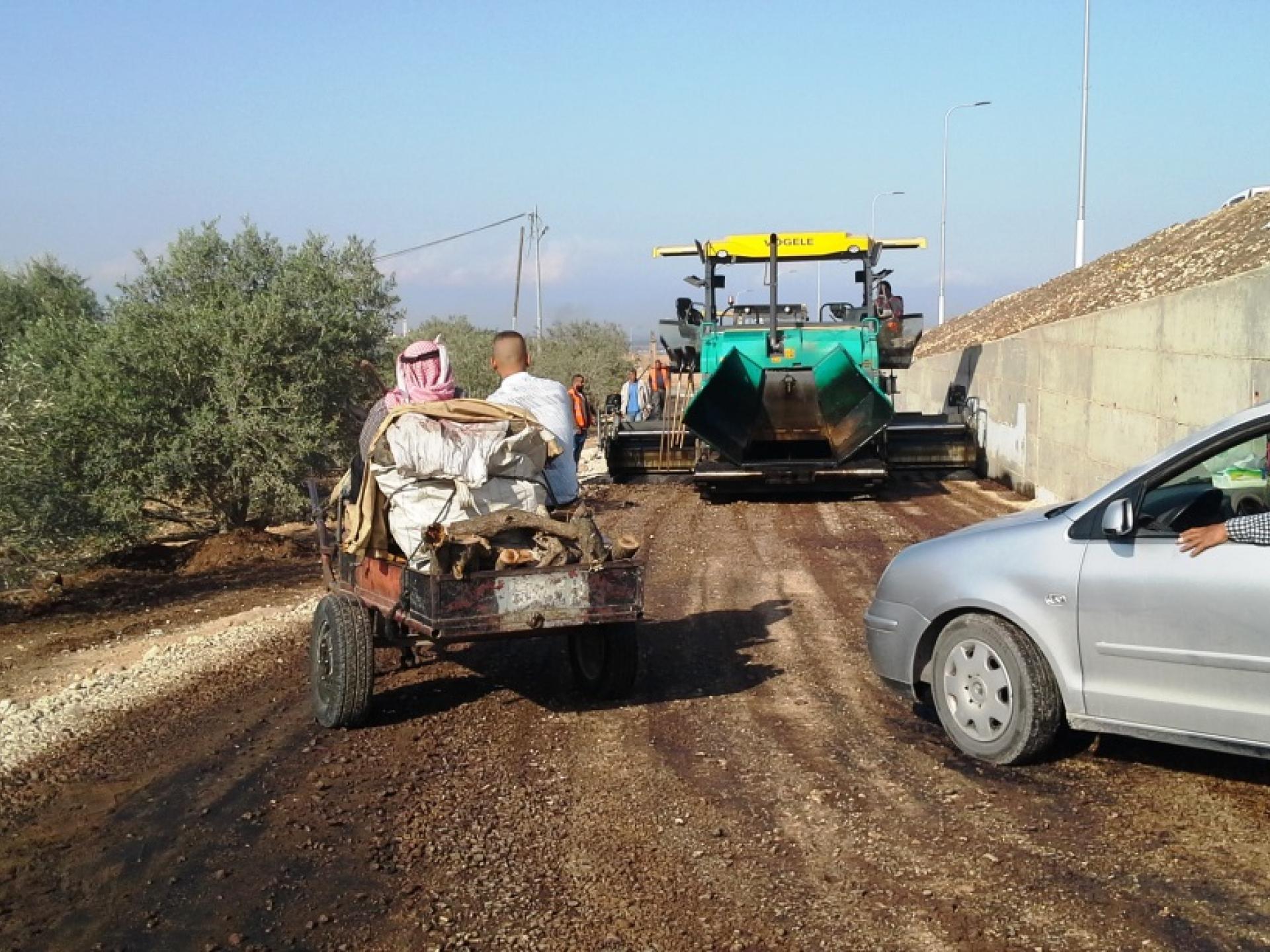 A big tractor making asphalt