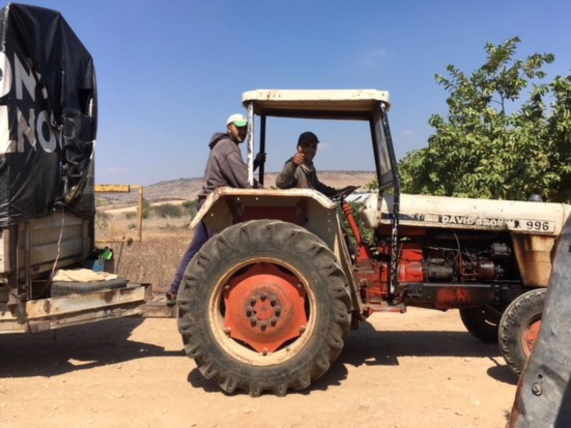 A tractor passes the Falamiya North CP