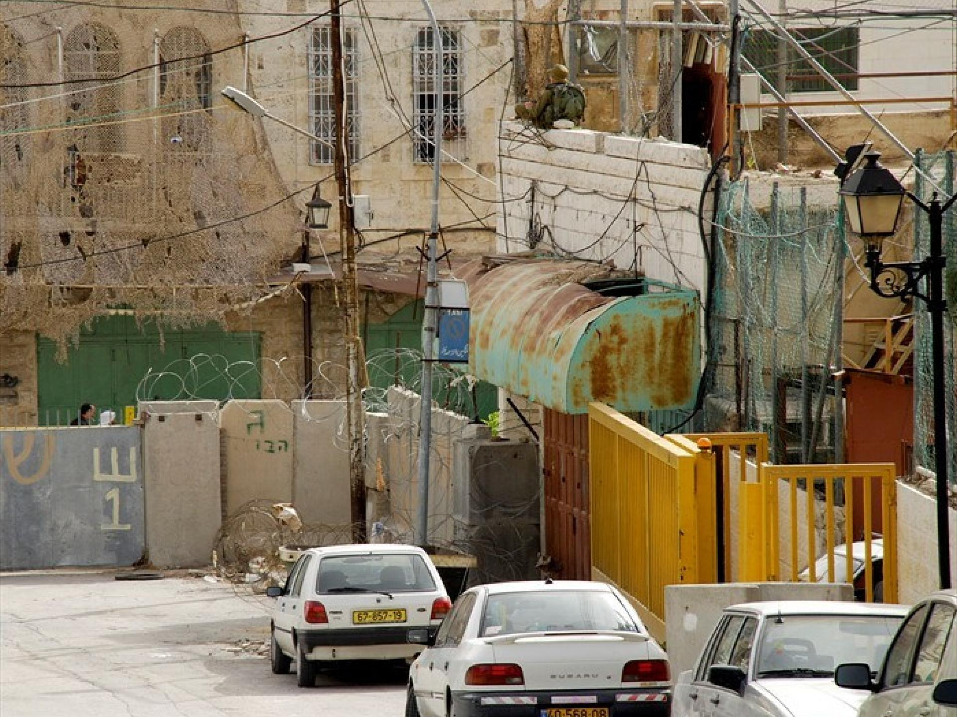 Hebron neighborhood marked by cement barriers and barbed wire