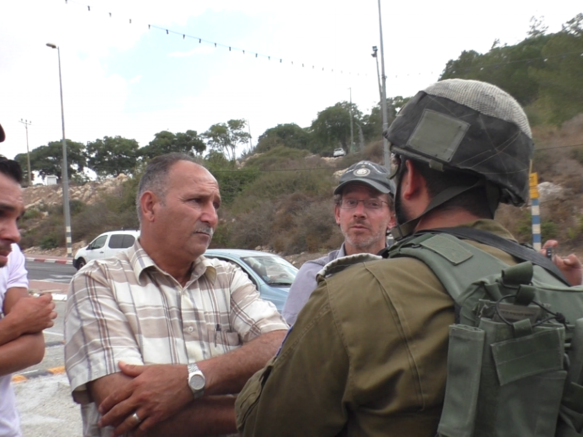 The landowner and his sons discussing access arrangements with the military commander