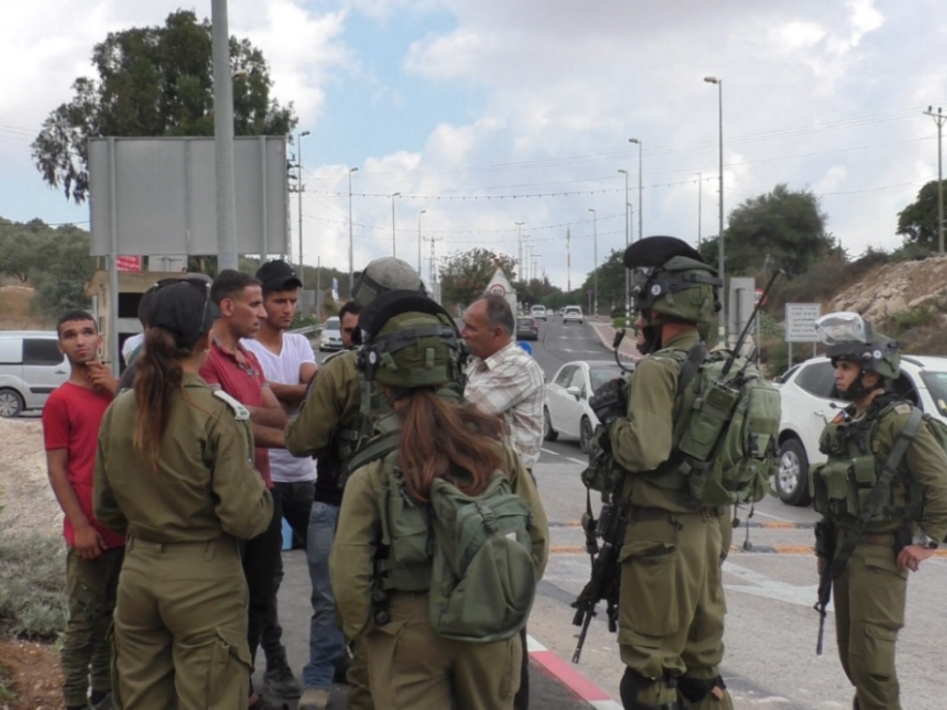 A discussion ensued between the uniformed personnel and the Palestinians and activists