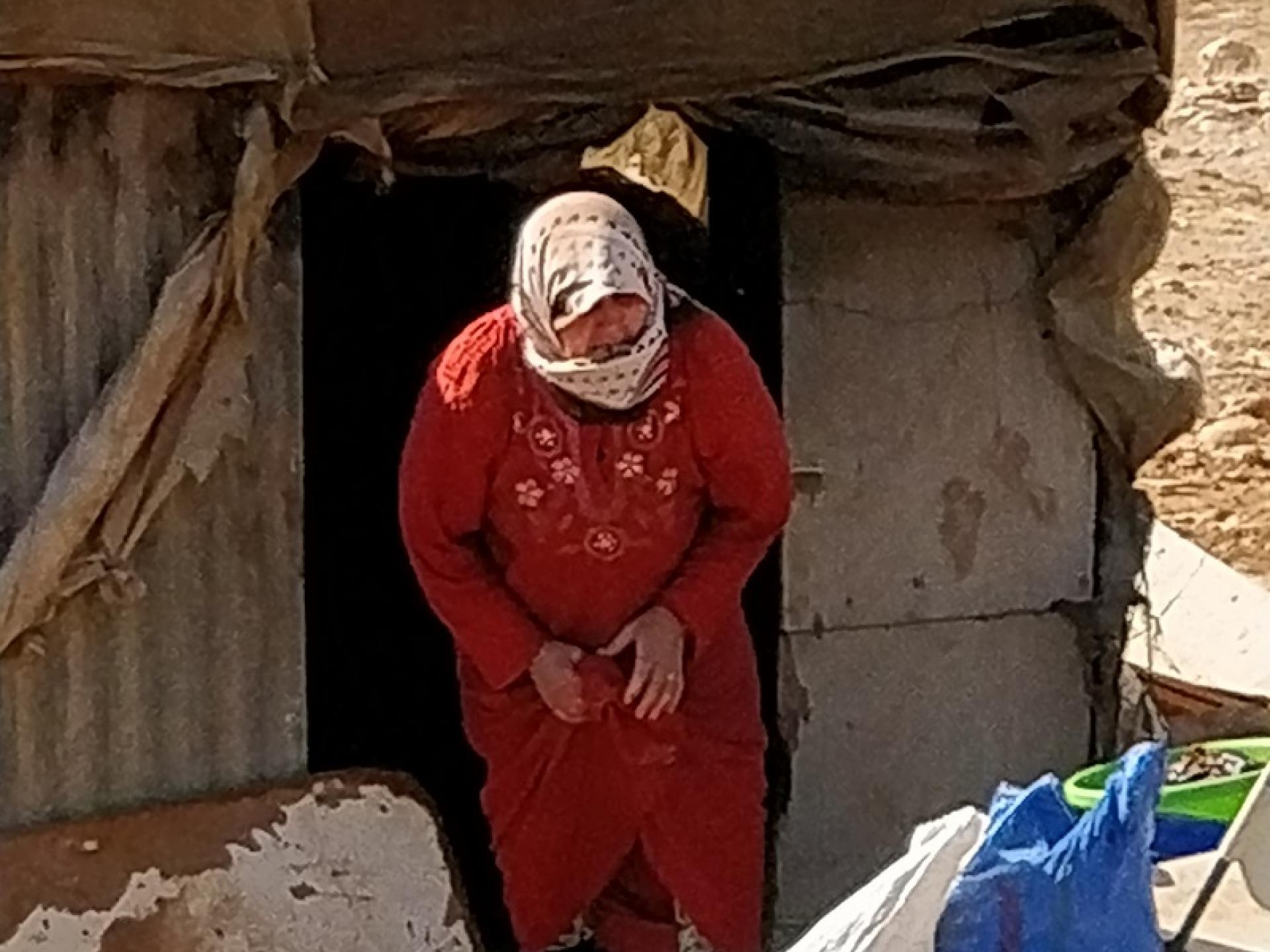 Yarza, Jordan Valley:  Just before she's forced to leave a woman extinguishes her clay oven