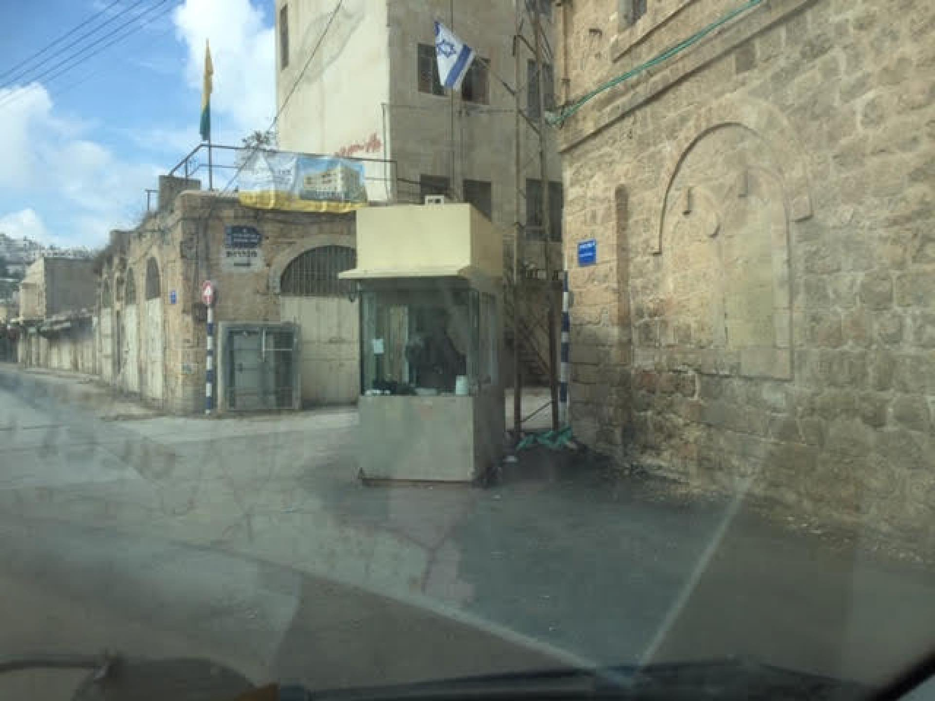 The checkpoint at the entrance to Abraham Our Father neighborhood