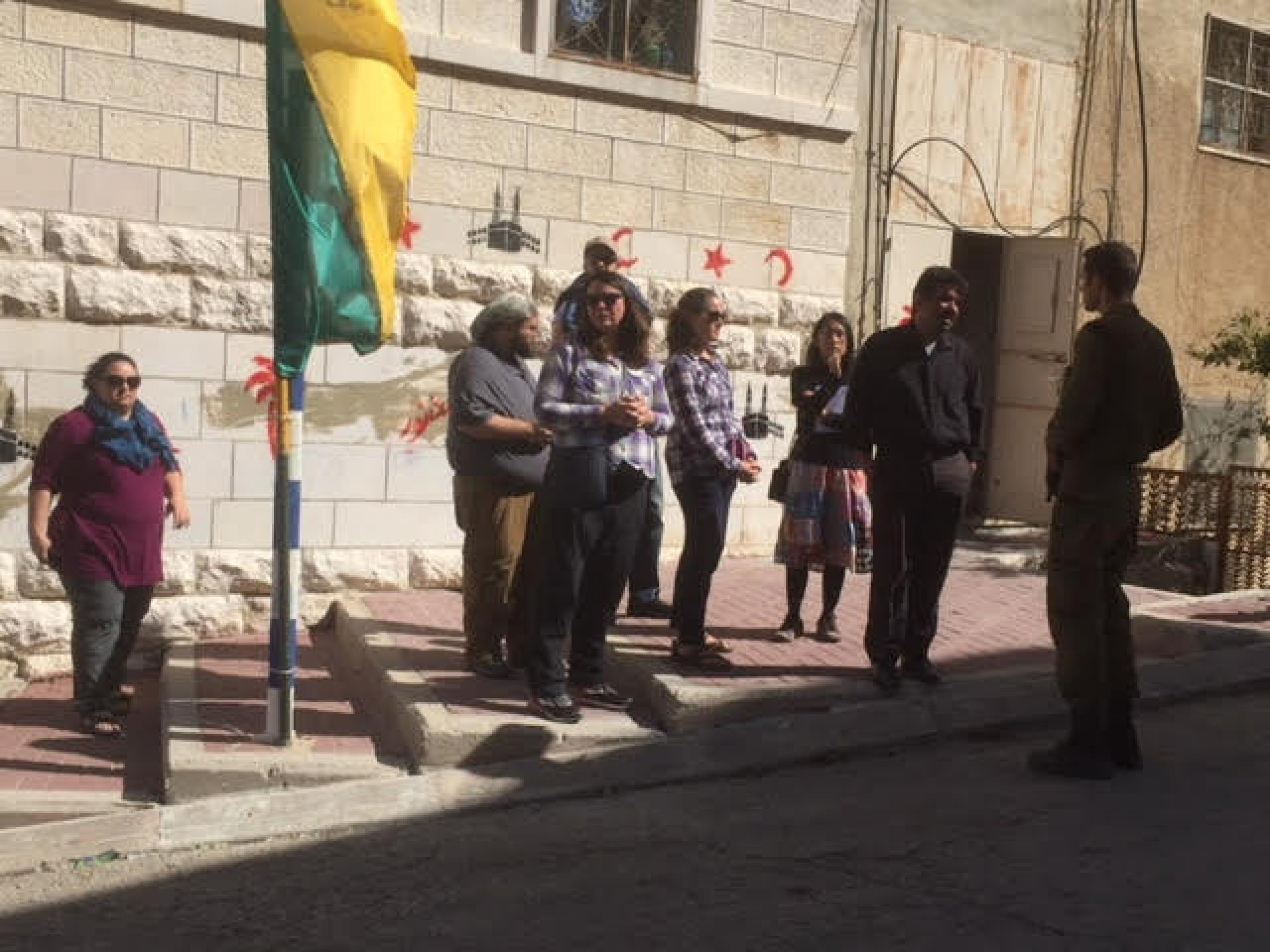 Soldiers hindering a group of Americans with a Palestinian guide from going to Tel Rumeida