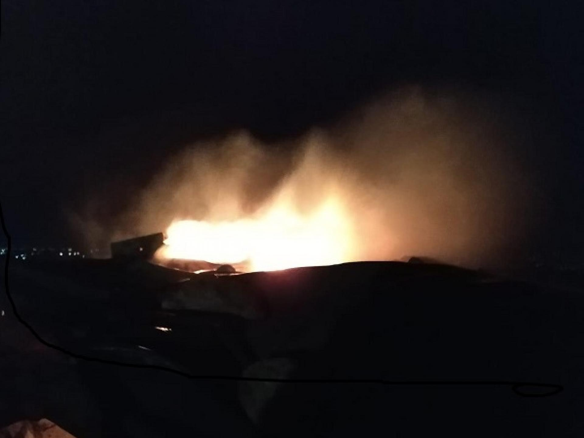the blaze taken by a neighbour in real time.  The photo that looks like a volcano is of the damaged tarpaulin that covers the oven