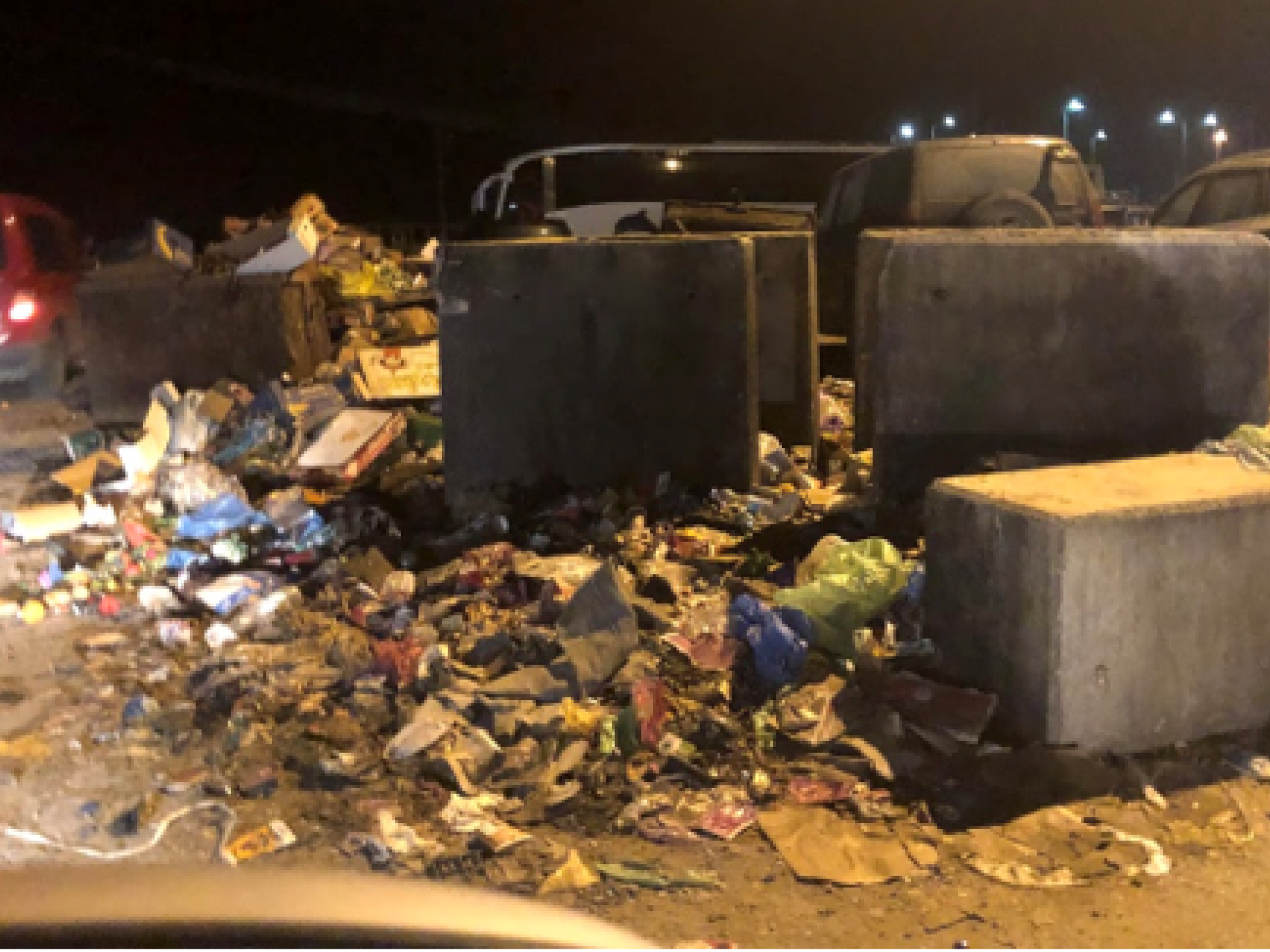 The piles of waste at the entrance to the Tarqumiya car park