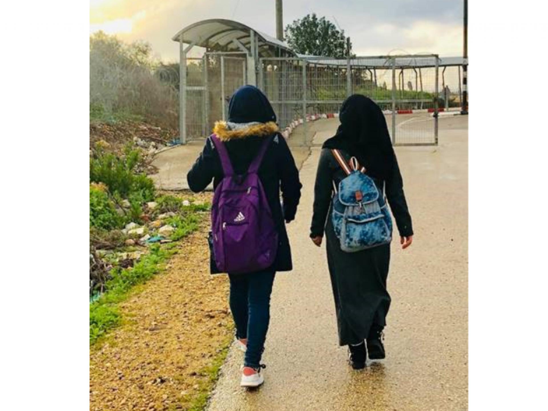 Girls on their way to school through Tura checkpoint