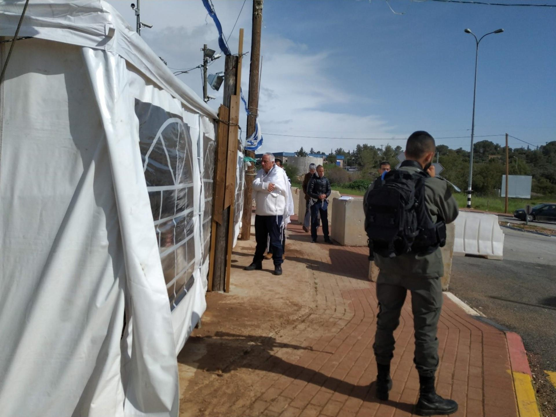 Halameesh Junction: a soldier guarding the entrance of a provisional synagogue tent