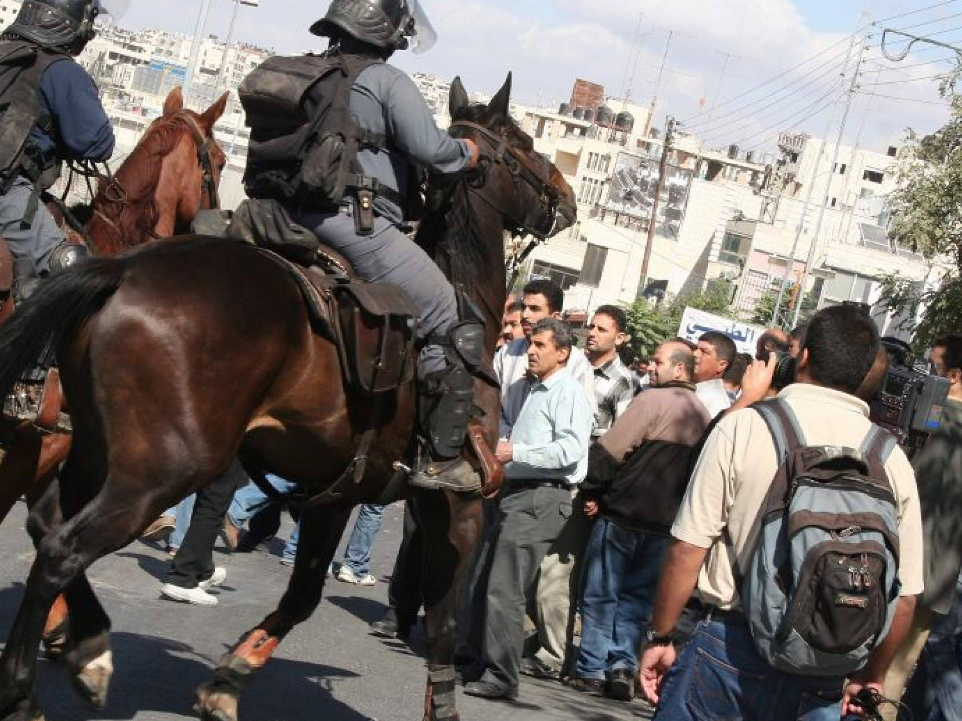 Mounted Policemen Controlling the Passage of Civilians