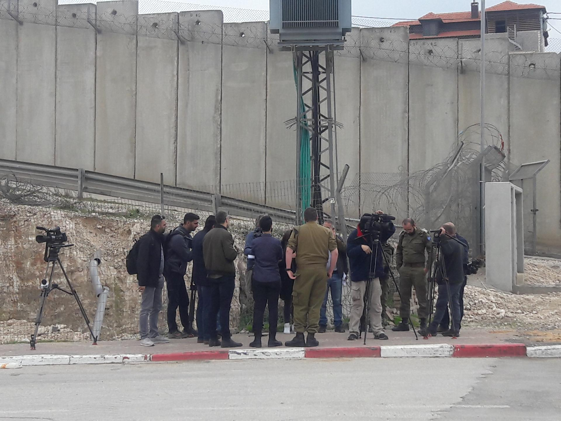 Soldiers briefing journalists on the new checkpoint in Qalandiya