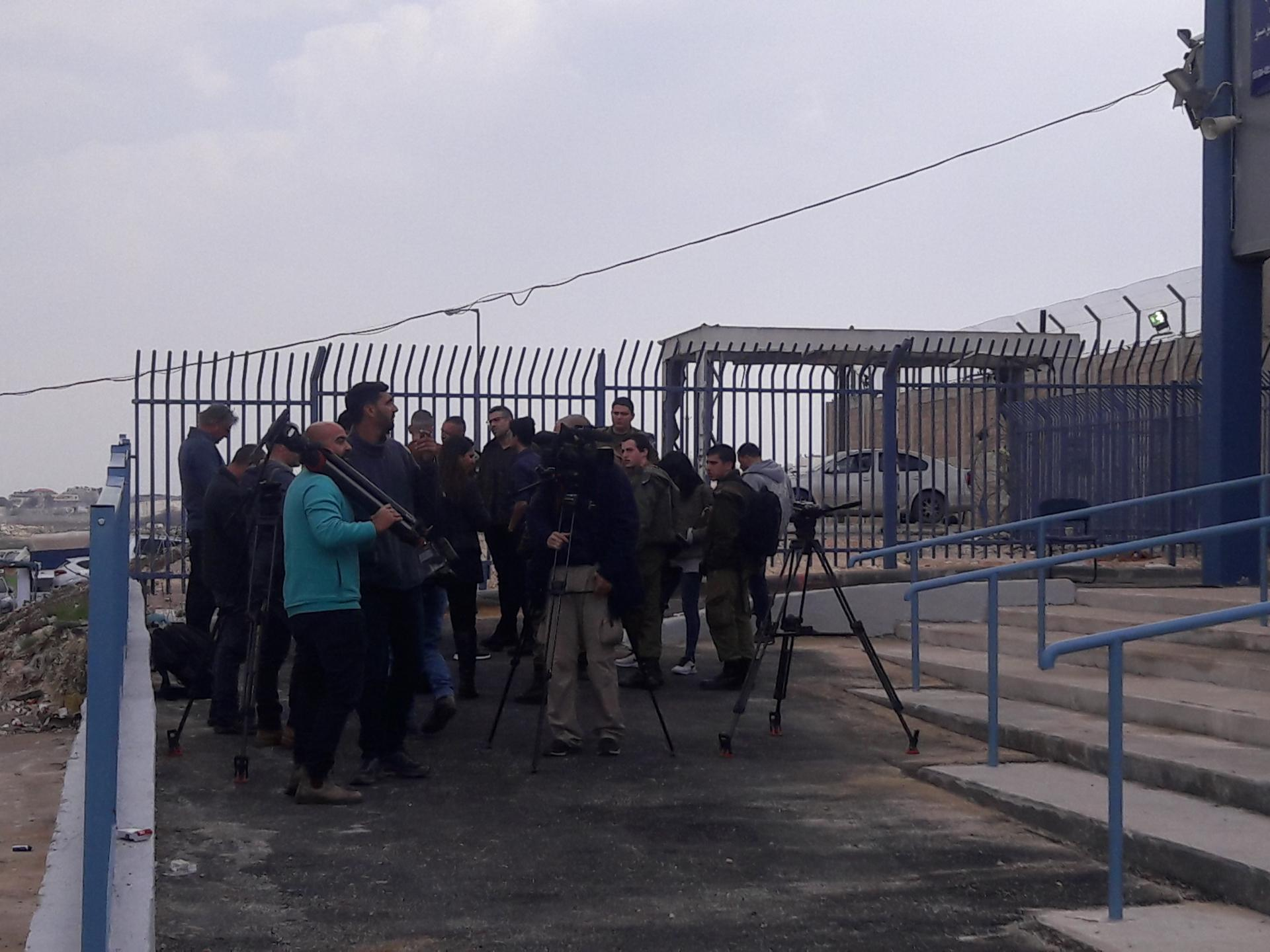 Journalists on the Palestinian side of the new checkpoint