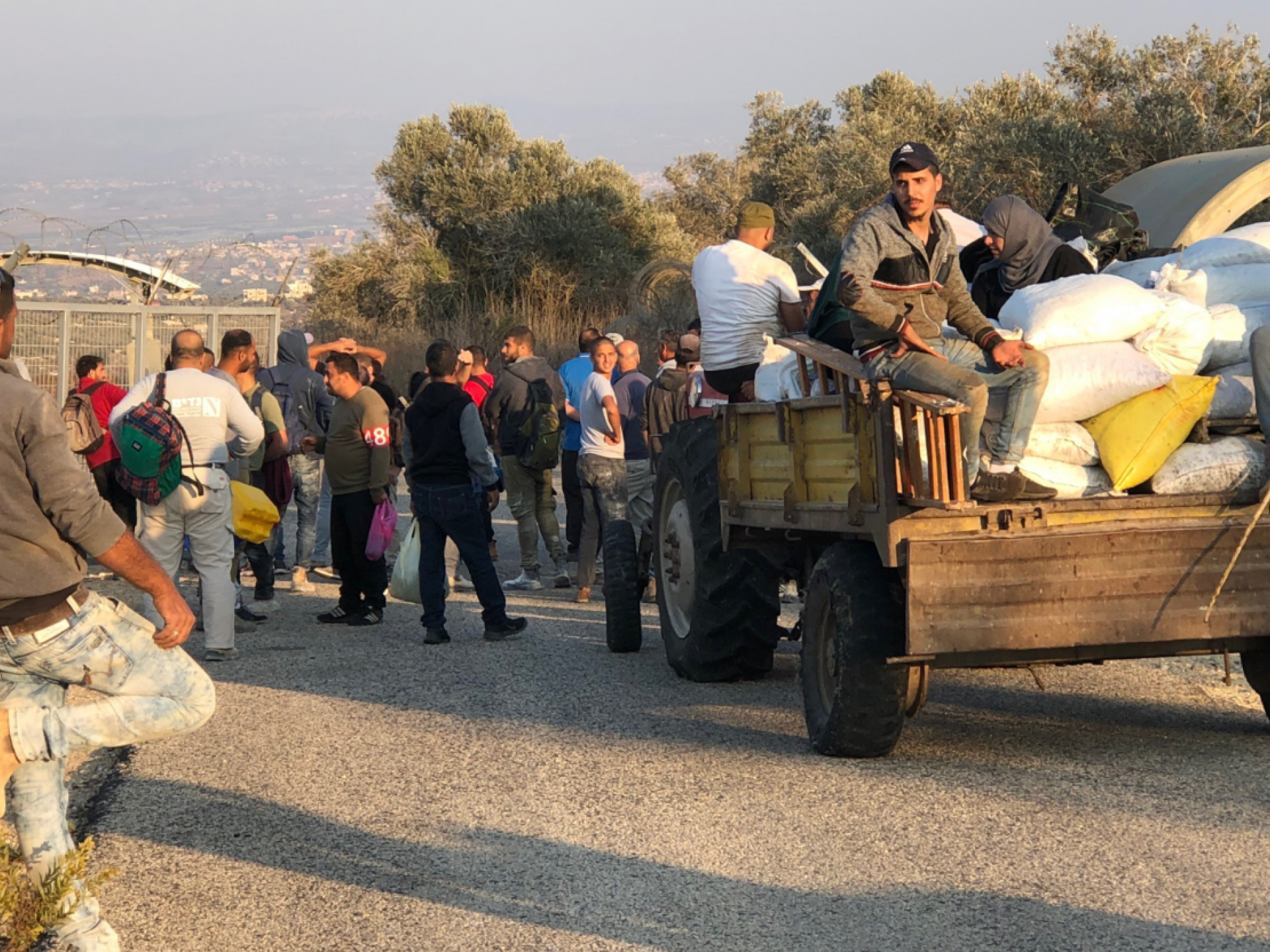 people and a carrige in front of a checkpoint