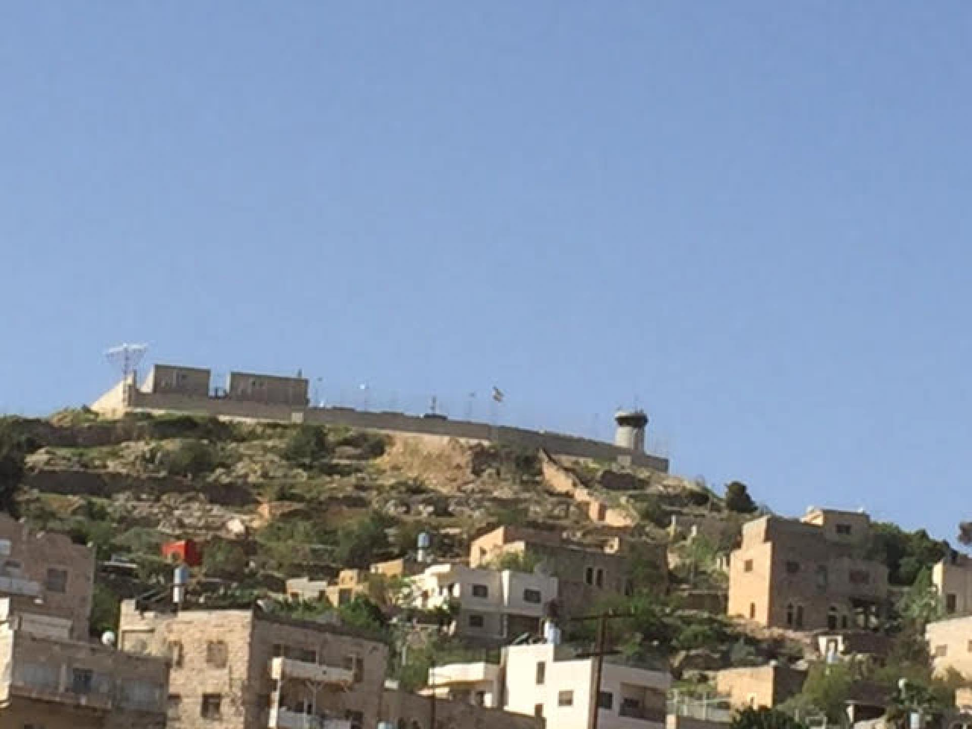 The pillbox above the Abu Snan neighborhood with the base built around it. Photographed from Gross Square