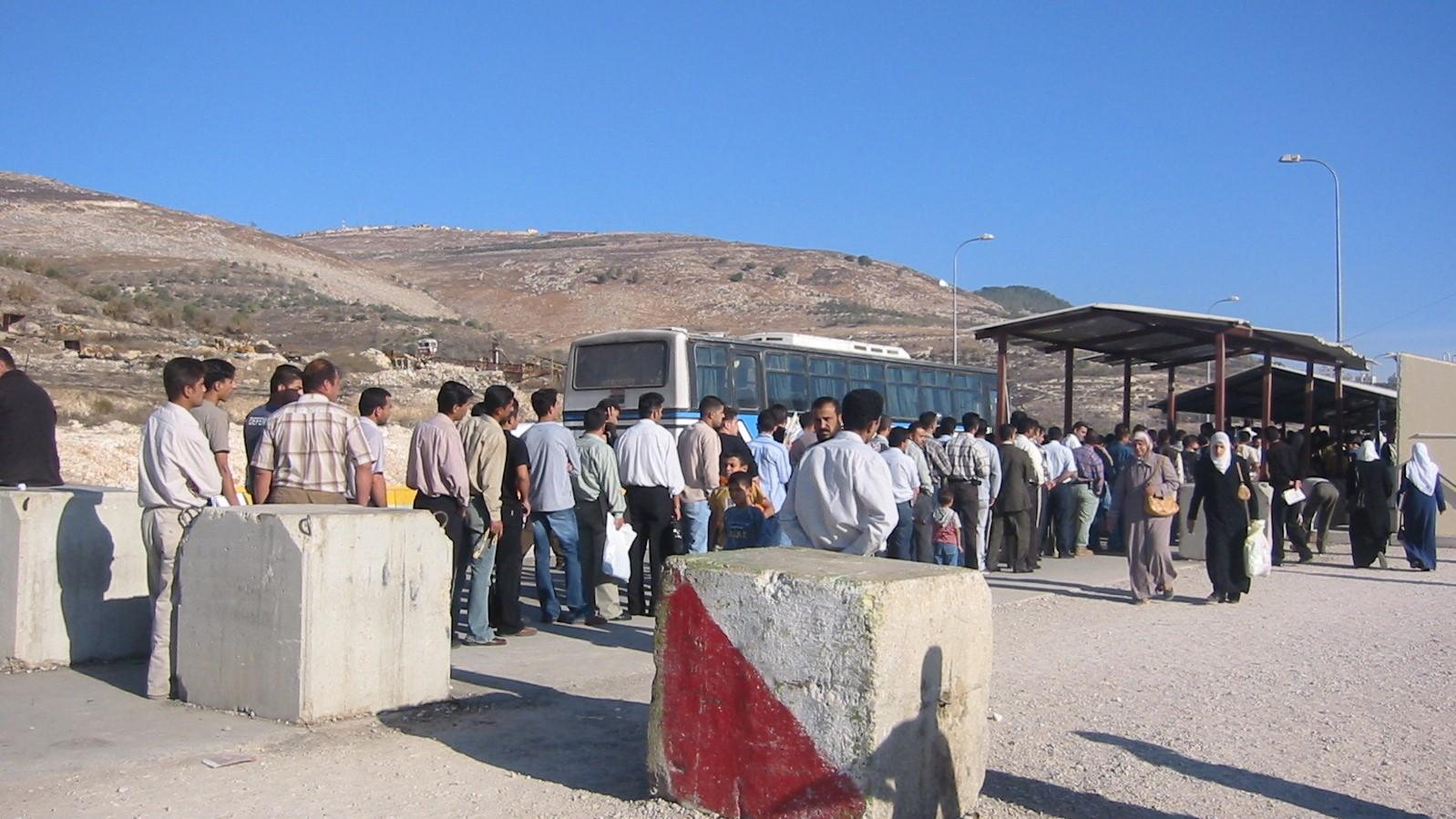 Men's line for checkpoint Hawara