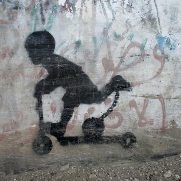 Local graffiti - A child on a scooter
