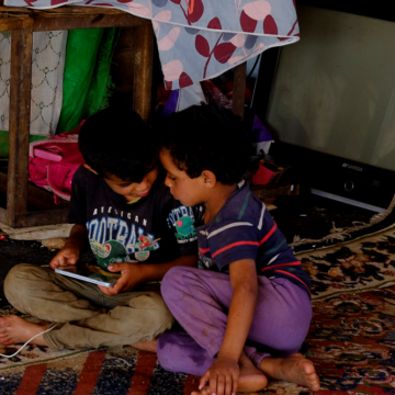 Two of the family's children absorbed in their tablet play